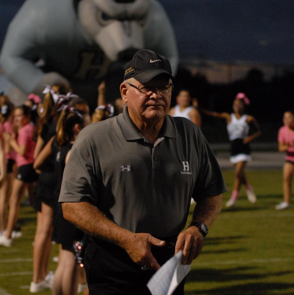 Coach Phil Ziglar walks to the sideline as he has just run out of the Husky before the Pinkd game against University Orange City. Hagerty went on to win 24-21 in double overtime.