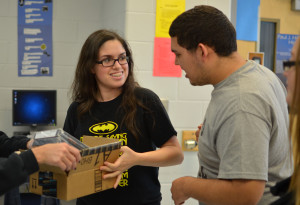 PALS president Karina Rodriguez delivers Kindle Fires purchased for local classrooms through the PALS Provides program.