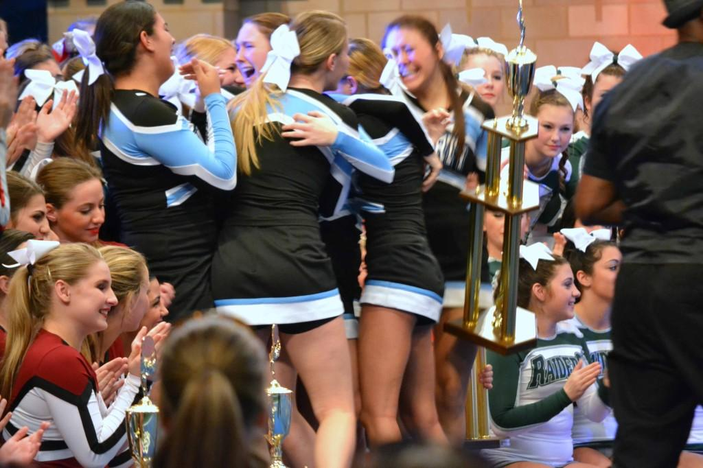 The cheer-leading team with their trophy