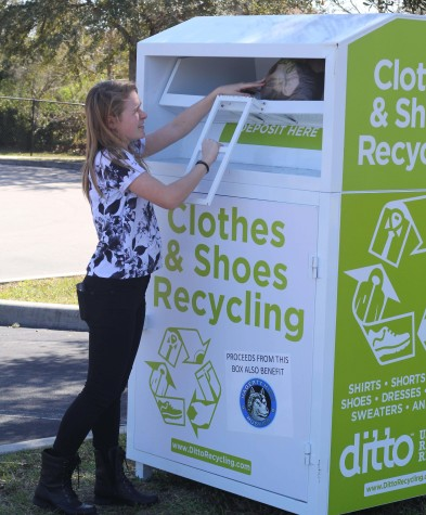 Student deposits clothes to benefit the less fortunate.