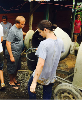 Agua Viva director Blake Davidson and junior Patrick Finster confirm a batch of cement has the correct proportions of sand and water.  Mixing cement was the job Finster enjoyed most at the work site.