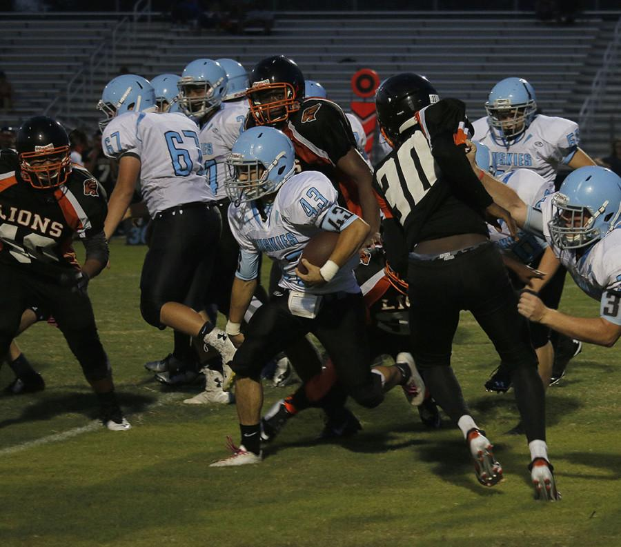 Running back Oliver Hart takes it between the tackles on a carry in a 31-0 win over Oviedo.