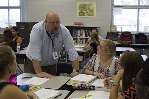 Bordelon helps students during class. This is Bordelons first year teaching at Hagerty.