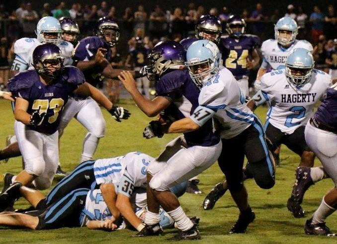 Linebacker Zachary Self gets ready to tackle a Winter Springs running back. The team's defense has allowed less than 20 points in each of its three season openers since the Ziglar era began.