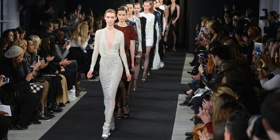 Models strut down the runway giving the audience one last chance to preview designs during the finale of a New York Fashion Week show.