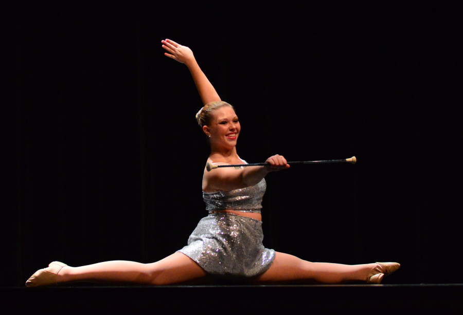 Senior Kautia Matyko exhibits her baton twirling skills at the talent show.  Matyko came in second place.