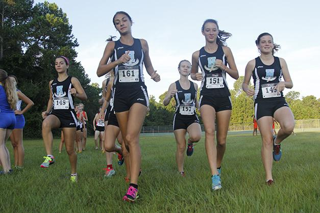 The+girls+team+warms+up+for+the+Oct.+24+District+Championship+meet+in+Deland.+
