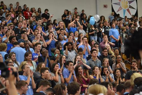 Juniors cheer on as the seniors turn their back during the competition for the spirit stick.