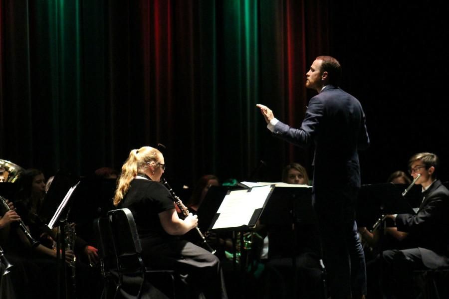 Band+director+Brian+Kuperman+conducts+the+band+for+the+classic+Christmas+song+%22Jingle+Bells%22+on+Friday%2C+Dec.+4+for+their+annual+Rhapsody+in+Blue+concert.+