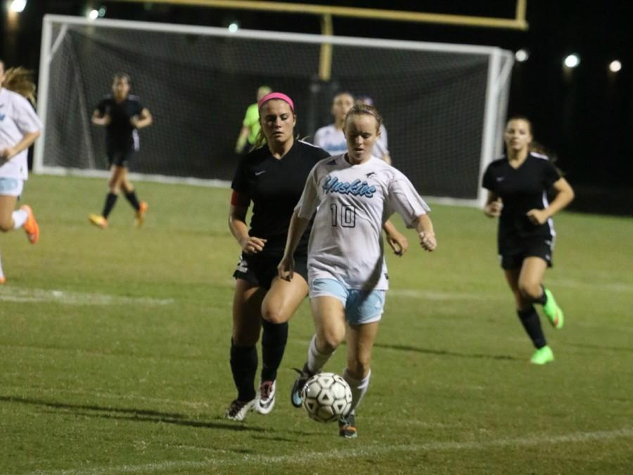 Center back Meghan Precord drives the ball across the field during a game against Lake Mary on Nov. 10.