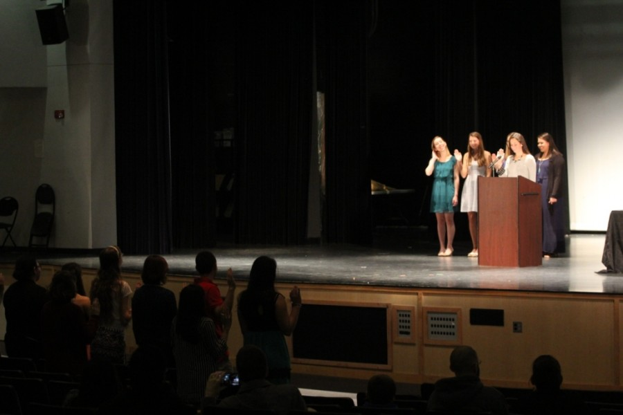 Attendees are sworn into the National Beta club during a ceremony.