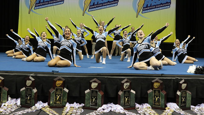 Cheer strikes a pose after performing in the state finals competition on Jan. 30 at USF's Sun Dome. The team, which was scored based off of execution and  routine difficulty, scored a record 92.45 points, the highest score ever awarded in the state competition.