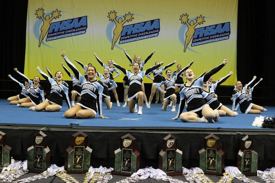 Cheer+strikes+a+pose+after+performing+in+the+state+finals+competition+on+Jan.+30+at+USF%E2%80%99s+Sun+Dome.+The+team%2C+which+was+scored+based+off+of+execution+and++routine+difficulty%2C+scored+a+record+92.45+points%2C+the+highest+score+ever+awarded+in+the+state+competition.+