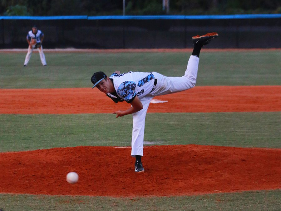 Pitcher Travis Hosterman pitches in a 7-1 loss against Oviedo on Wednesday, April 6. Despite the loss, the team split the season series with Oviedo, 1-1, and remains atop the district.