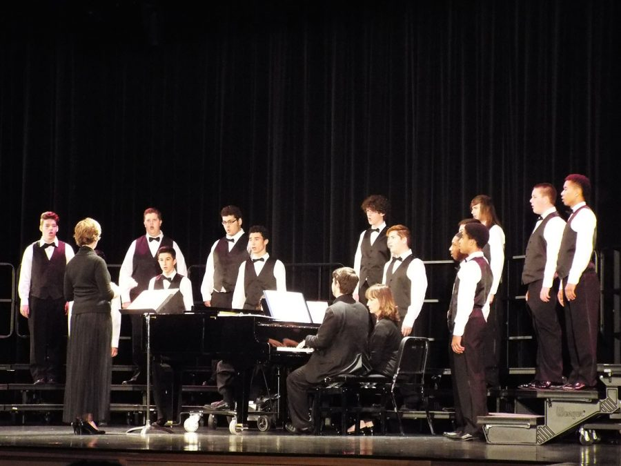 The boy's choir performs to the backdrop of two pianists.