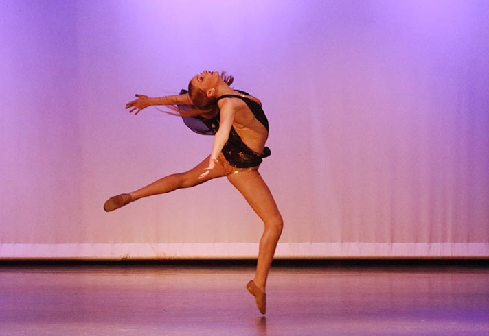 Dance+student+performs+a+lyrical+solo+at+the+March+17+show.+