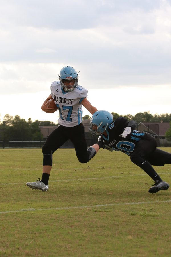 "Quarterback Matt Lipari avoids a defender in the Black and Blue Scrimmage game on Friday, May 13. The blue team went on to win 17-7. ""We now feel prepared for Oviedo,"" Lipari said."