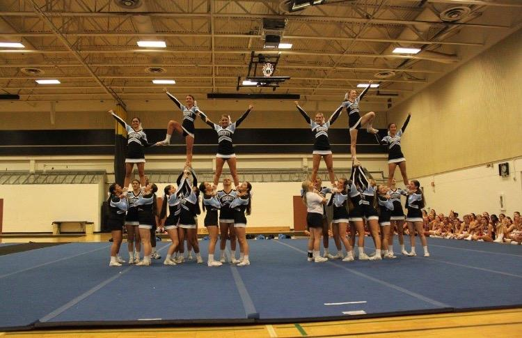 During+their+final+performance%2C+the+varsity+team+builds+a+pyramid.+The+bases+have+new+grips+that+were+taught+to+them+by+the+UCA+staff.%0A