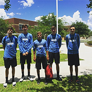 Jacob Faulk, MIchael Gibson, Jordan Engel, James Chapman and Lincoln Mitchell stand outside Oviedo High School at a camp. This was one of 4 camps the team attended this summer.