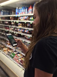 Freshman Aly Schwartz plays Pokémon Go as she shops in Publix with her mother. Schwartz had been playing the game ever since it was recommended to her over social media.