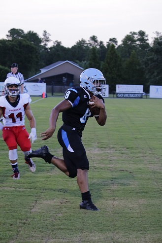 Running back Tavis Thompson scores the team's second rushing touchdown in the Kickoff Classic. The team won 28-13.