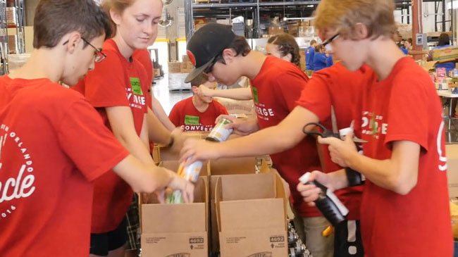 At Second Harvest Food Bank, senior Megan McKeel and her small group sort through canned goods.