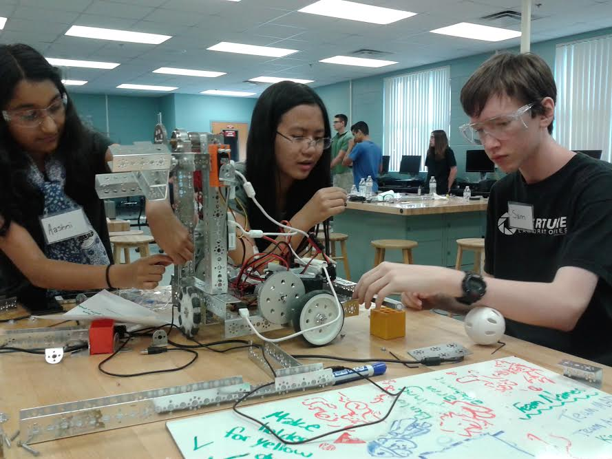 Aashni Patel (left) builds her robot for the camp's competition. The robot was built to be tested against the other teams.