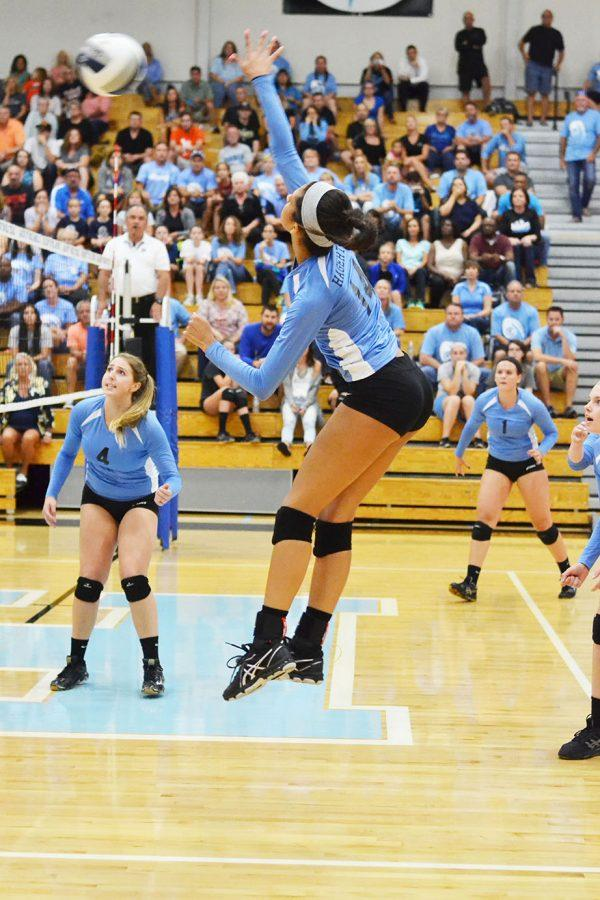 Outside hitter Leandra Mangual spikes  the ball against Oviedo on Thursday, Sept. 8. Mangual finished with 13 kills despite a 3-2 loss.