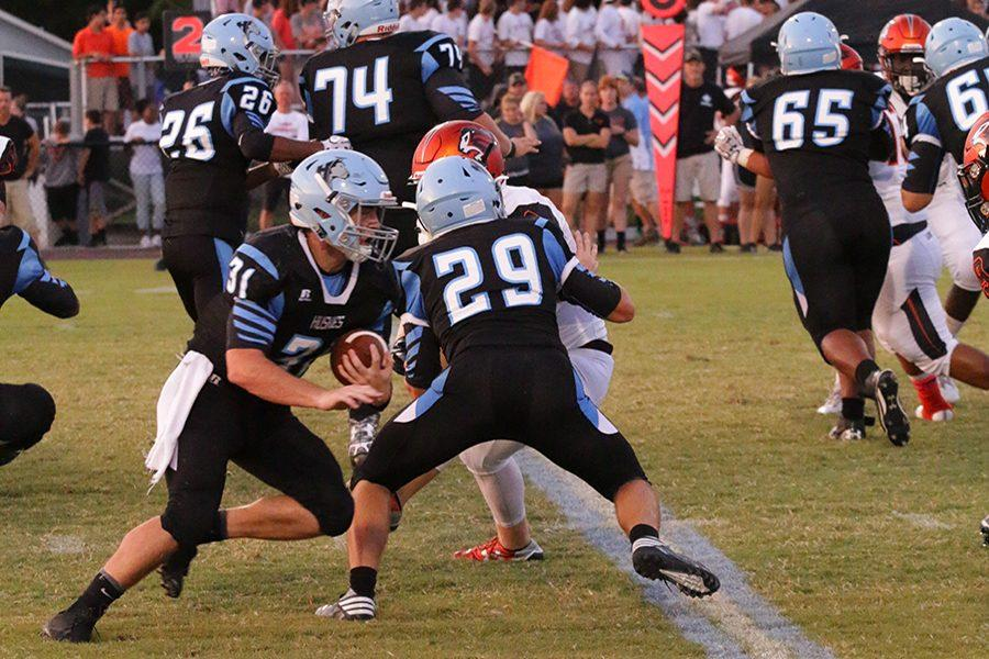 Quarterback Ethan Brewer runs the ball in the first half. The team beat Oviedo 17-10 Friday night, its first win over Oviedo since 2010.