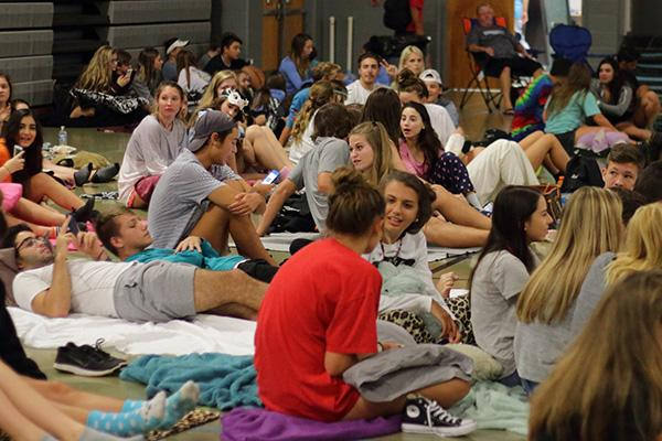 Students settle in in the old gym for the movie.  Flick on the 50 had to be moved indoors due to rain.