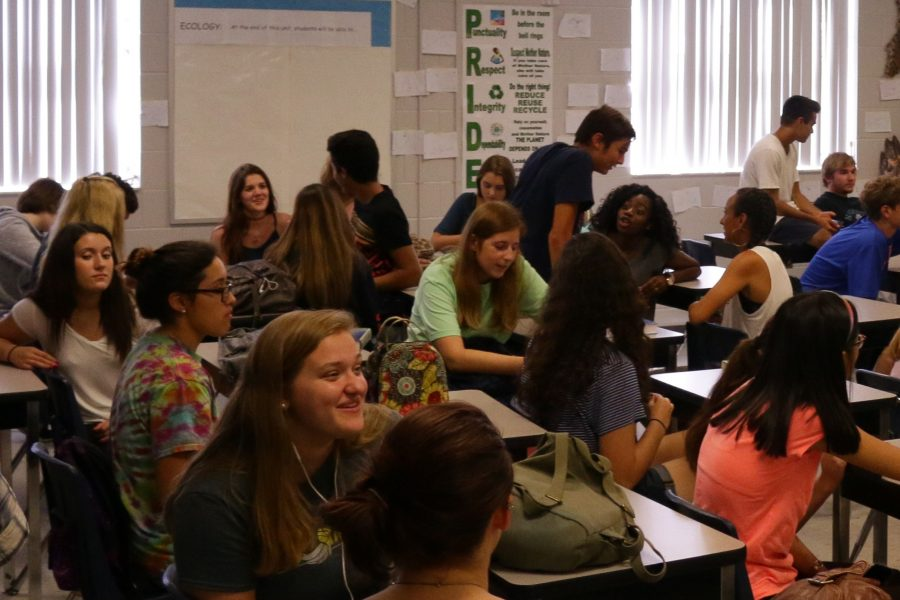 Environmental Science club members socialize before the meeting starts. Most participants were juniors and seniors.