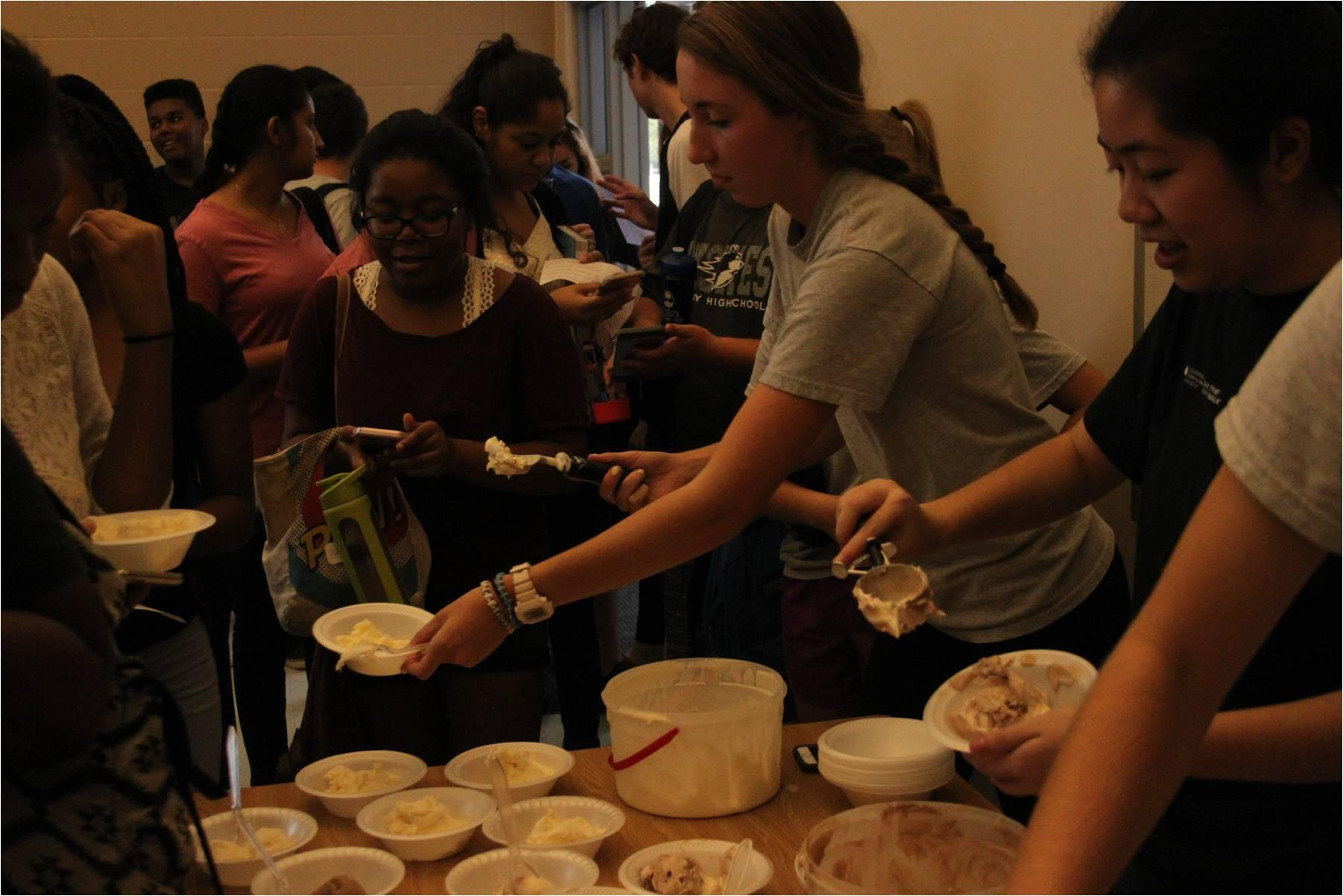 Key Club officers,  Madison Pleasants and Christina Nguyen serve ice cream to members. The first meeting was held in the Group Projects Room.