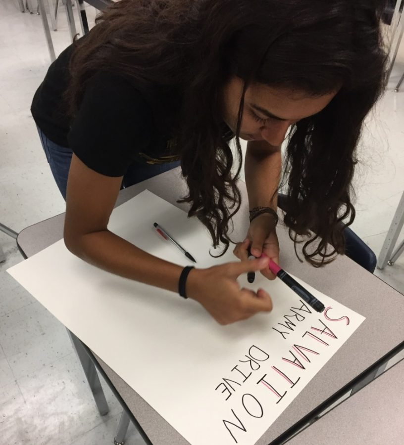 Sophomore Valeria Portillo creates a poster to advertise the drive.