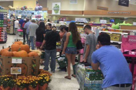 Checkout lines in Publix stretch around the store. Hurricane Matthew is scheduled to hit Thursday night.