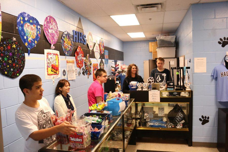 ESE students Gustavo Guevara, Jimmy Rifenberg, and Ryan Elliot work in the school store selling and organizing items to other students.