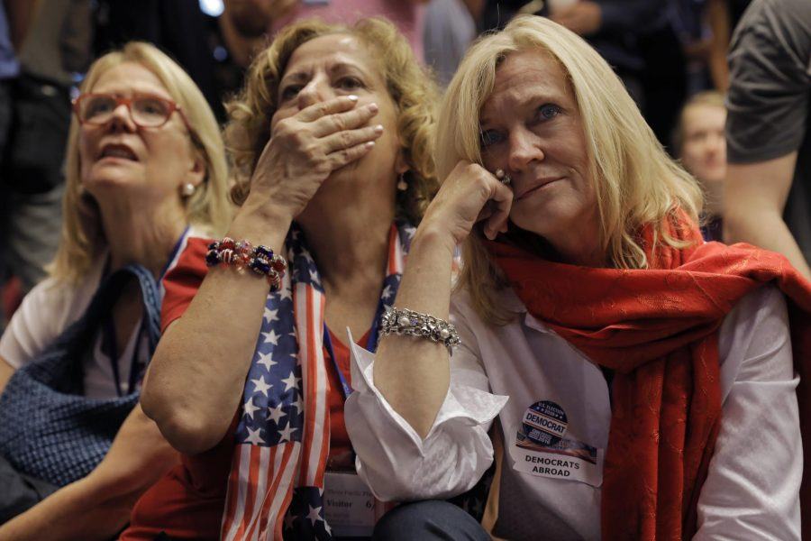 Guests react to a broadcast of the election in Hong Kong on Wednesday, Nov. 9.