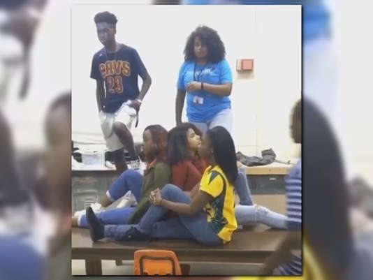 A screenshot of the Mannequin Challenge,  done by the Edward White High School students who were the  first ones to do it.