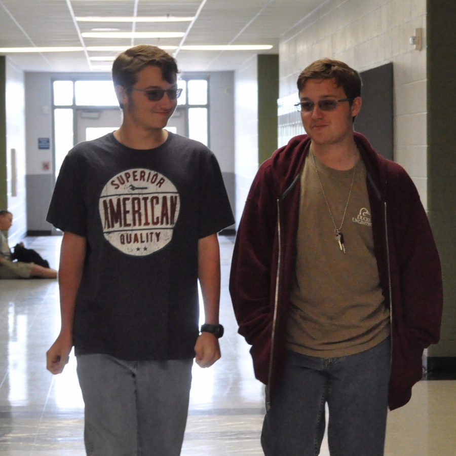 Sophomores Cameron and Nicholas Smith walk together having a brother-to-brother time. The Smiths had most of their relatives over for the holidays for a week and a half.