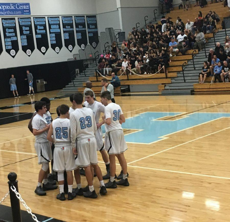 The team regroups during a time-out at the game against rival Oviedo with a final score of 69-68.