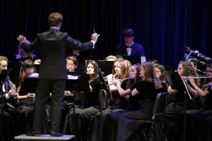 Band director Brad Kuperman conducts the band for a performance on stage for the annual Rhapsody in Blue concert on Friday, Dec. 2.