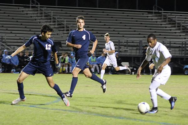Forward Scott Benoit dribbles the ball in an attempt to evade the other team. Benoit scored twice in the team's, 8-0, thrashing of Lake Brantley.
