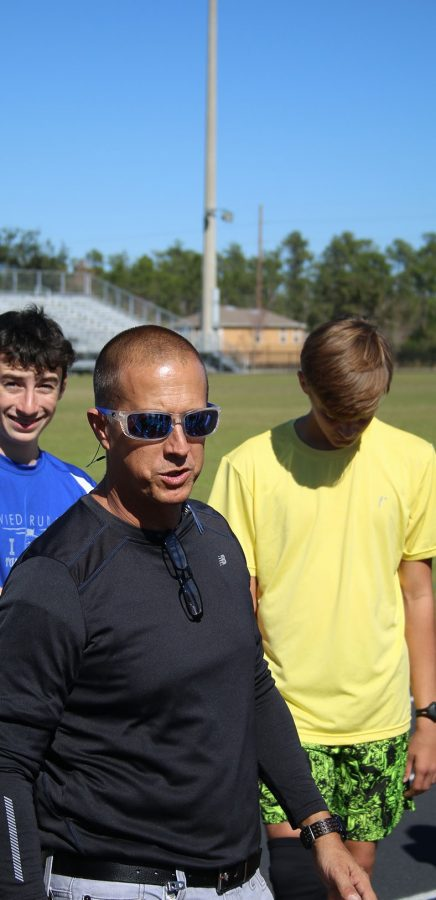 Cross country and track head cosch Jay Getty talks to the boys track team in practice on  Wednesday, Feb. 1.