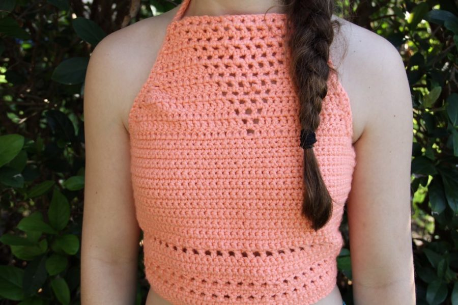 Freshman Samantha Gonos poses one of Trimboli's crochet tops. These are a new component of her business that cost $25 each.