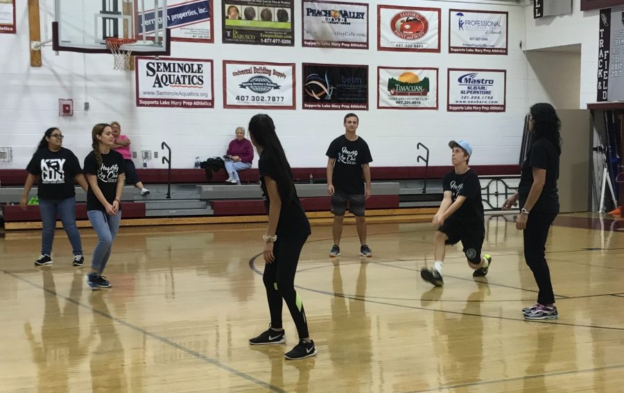 Key Club members play volleyball with club sponsor Ntiza Ariza during the Special Olympics event. At the event, members played soccer, volleyball, track and basketball with the special needs athletes.