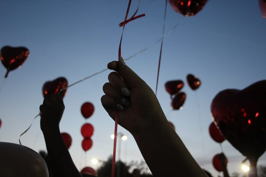 After+Chris+Johnsons+family+spoke%2C+the+crowd+released+red+balloons.++Click+below+to+hear+the+remarks+of+Johnsons+mother+at+the+beginning+of+the+vigil.