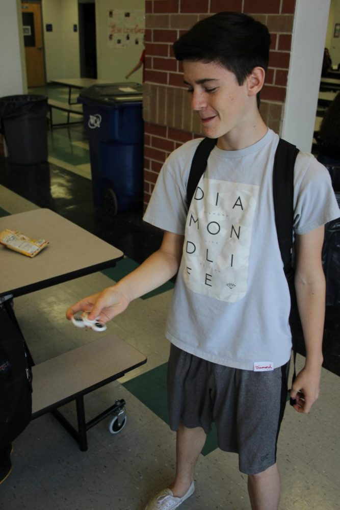 Freshman+Colin+Lamkin+shows+off+his+fidget+spinner+skills+for+fun+during+second+lunch.