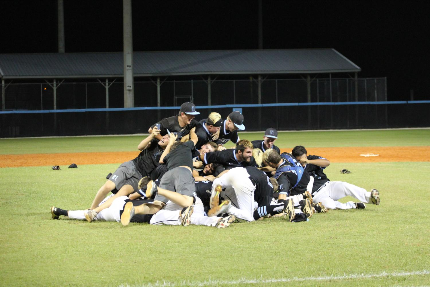 The+baseball+team+celebrates+after+a+6-2+win+in+the+regional+final+against+George+Jenkins.+The+team+will+play+in+the+state+semifinals+on+Friday%2C+June+2+against+Sarasota+in++Fort+Meyers.+