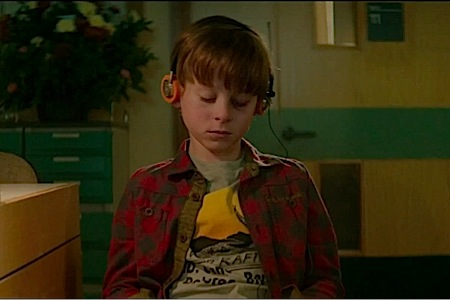 A young Peter Quill (Wyatt Oleff) listens to his Walkman during the beginning of Guardians of the Galaxy.