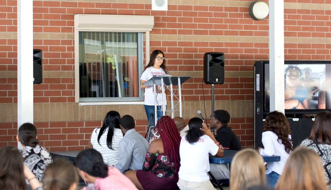 A student speaks in front of the crowd of the memorial for Johnson held on Saturday, May 6.
