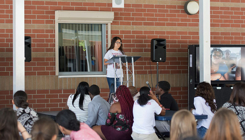 A student speaks at the memorial held on Saturday, May 6.